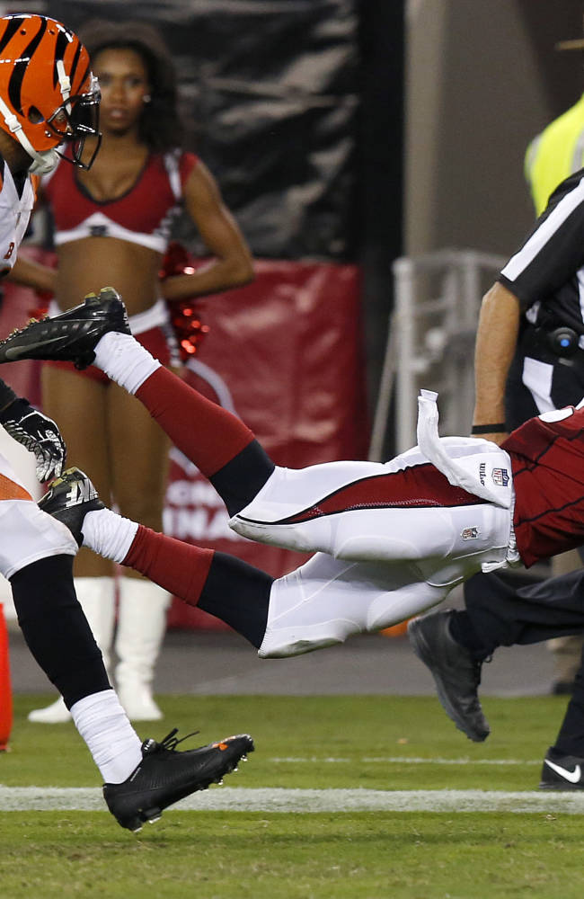 Arizona Cardinals wide receiver John Brown (12) makes a diving touchdown catch as Cincinnati Bengals defensive back R.J. Stanford (28) defends during the second half of an NFL preseason football game, Sunday, Aug. 24, 2014, in Glendale, Ariz