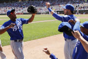 Kansas City Royals center fielder Lorenzo Cain celebrates with teammates after making the catch on a fly ball by Minnesota Twins' Trevor Plouffe in the fifth inning of a baseball game in Minneapolis on Thursday, Aug. 1, 2013. The Royals won 7-2. (AP Photo/Andy Clayton-King)