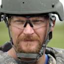 NASCAR driverDale Earnhardt Jr. waits to shoot a M4 Rifle with soldiers at Camp Atterbury Wednesday, July 23, 2014, in Edinburgh, Ind. (AP Photo/Darron Cummings)