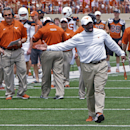 Texas coach Charlie Strong calls out to his players during the first half of the team's Orange and White spring NCAA college football game, Saturday, April 19, 2014, in Austin, Texas. (AP Photo/Michael Thomas)