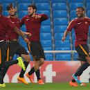 Roma's Ashley Cole, right, reacts with teammates, during a training session, at the Etihad Stadium, in Manchester, England, Monday, Sept. 29, 2014. Roma will be playing Manchester City in a Champions League Group E soccer match on Tuesday