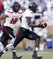 Texas Tech's Will Smith (7) scores a touchdown after a Texas State fumble with Pete Robertson (10) during their NCAA college football game in Lubbock, Texas, Saturday, Sept. 21, 2013. (AP Photo/Lubbock Avalanche-Journal, Stephen Spillman)