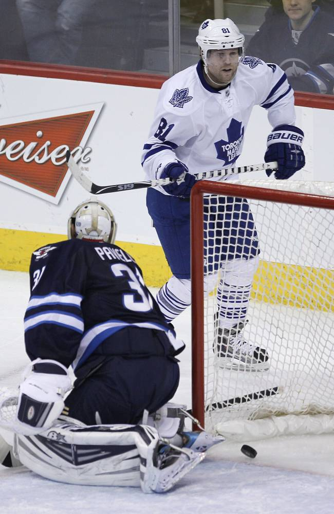 Toronto Maple Leafs' Phil Kessel (81) scores the equalizer against the Winnipeg Jets during the third period of an NHL hockey game Saturday, Jan. 25, 2014, in Winnipeg, Manitoba. The Jets won 5-4 in overtime