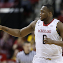 Maryland forward Charles Mitchell points to a teammate after scoring in the first half of an NCAA college basketball game against Virginia Tech in College Park, Md., Tuesday, March 4, 2014. (AP Photo/Patrick Semansky)