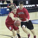 Georgia's Ashley Houts battles assistant coach Cameron Newbauer for the ball during NCAA college basketball practice in Sacramento, Calif., Friday, March 16, 2010. Georgia will play Stanford in the semi-finals of the Sacramento Regional of the women's tournament.(AP Photo/Rich Pedroncelli)
