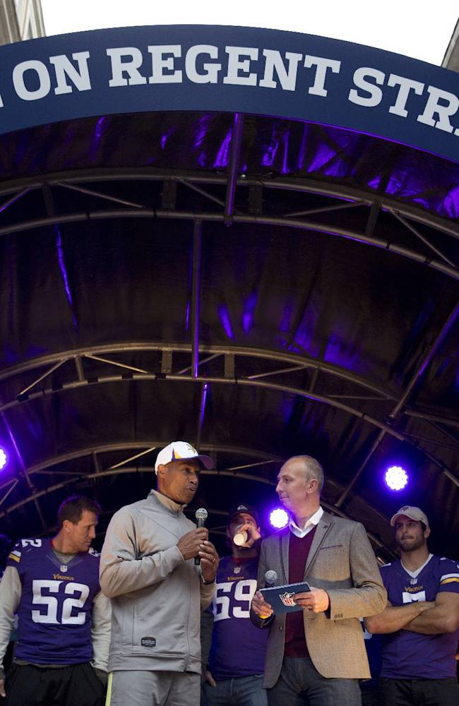 Minnesota Vikings' head coach Leslie Frazier, center left, speaks on stage flanked by members of his team during an NFL fan rally event in Regent Street, London, Saturday, Sept. 28, 2013.  The Minnesota Vikings are to play the Pittsburgh Steelers at Wembley stadium in London on Sunday, Sept. 29 in a regular season NFL game
