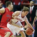 Indiana's Jordan Hulls, right, and Ball State's Michael Ramey go for a loose ball during the second half of an NCAA college basketball game, Sunday, Nov. 25, 2012, in Bloomington, Ind. Indiana won 101-53. (AP Photo/Darron Cummings)