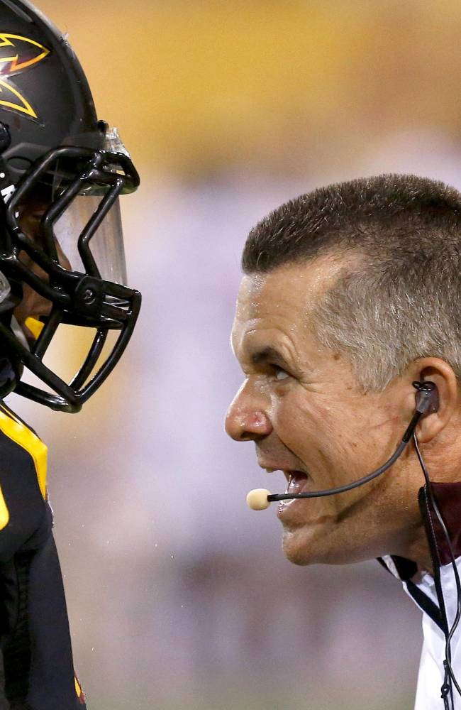 In this Sept. 14, 2013, file photo, Arizona State head coach Todd Graham, right, tries to make a point to Anthony Jones during the second half in an NCAA college football game against Wisconsin.  Arizona State has gotten through a difficult stretch in the schedule in decent shape outside of a horrendous start against No. 5 Stanford. Beating Notre Dame on Saturday at the end of this four-game gauntlet would be a nice capper for the No. 22 Sun Devils, giving them a huge boost on the national stage