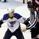 St Louis Blues' Kevin Shattenkirk (22) argues with linesmen John Grandt (98) and Pierre Racicot (65) after being called for an interference penalty during the second period of an NHL hockey game against the Phoenix Coyotes on Sunday, March. 2, 2014, in Gl