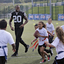 Oakland Raiders Darren McFadden plays football with children during an event at Guildford, England, Tuesday, Sept. 23, 2014. The Raiders will play the Miami Dolphins in an NFL football game at London's Wembley Stadium on Sunday Sept. 28. The Associated Pr