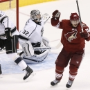 Arizona Coyotes' Shane Doan, right, celebrates the game-winning goal by teammate Oliver Ekman-Larsson against Los Angeles Kings' Jonathan Quick (32) as Kings' Matt Greene (2) skates past during overtime in an NHL hockey game Saturday, Oct. 11, 2014, in Gl