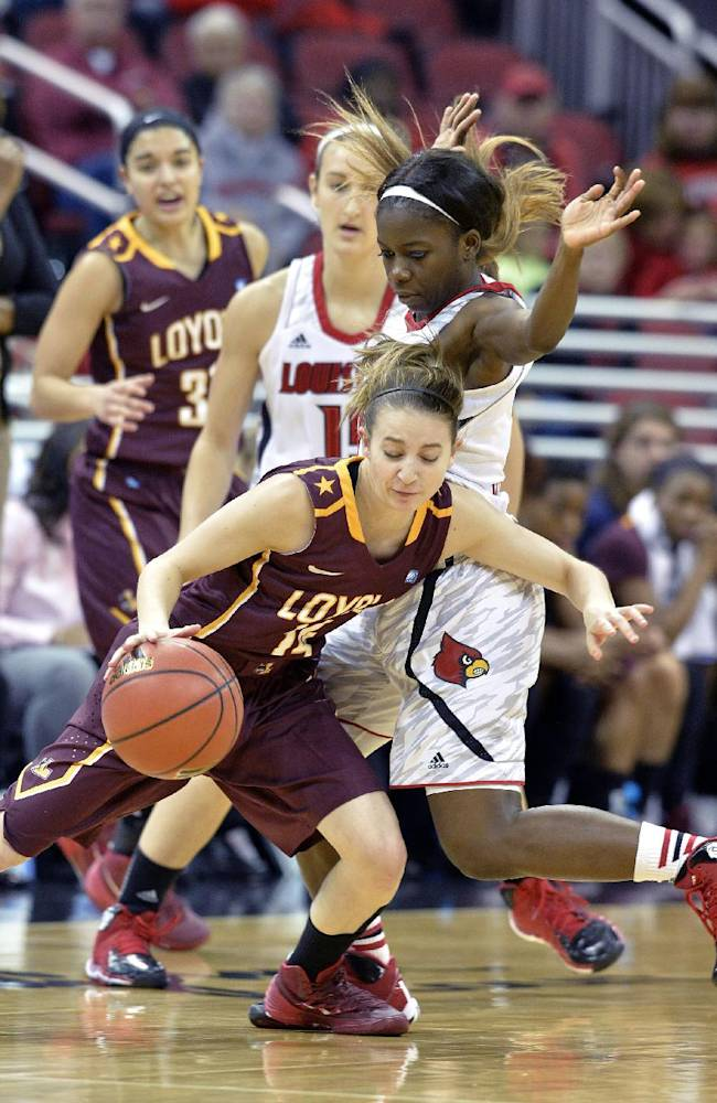 Loyola Chicago's Erin Thomas, front, attempts to drive around the defense of Louisville's Monny Niamke during the second half of an NCAA college basketball game, Saturday, Nov. 9, 2013, in Louisville, Ky. Louisville defeated Loyola Chicago 101-54