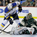 Minnesota Wild goalie Niklas Backstrom (32), of Finland, deflects a shot by St. Louis Blues right wing T.J. Oshie (74) during the second period of an NHL hockey game in St. Paul, Minn., Saturday, Nov. 29, 2014 The Associated Press