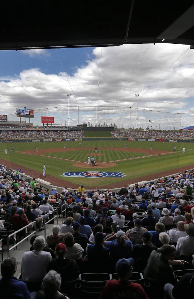 The Arizona Diamondbacks and the Chicago Cubs compete during the third inning of a spring training baseball game on Thursday, Feb. 27, 2014, in Mesa, Ariz