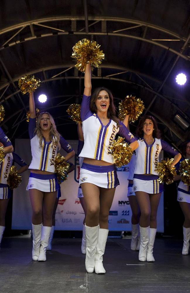 The Minnesota Vikings Cheerleaders perform on stage during an American football NFL fan rally event in Regent Street, central London, Saturday, Sept. 28, 2013.  The Minnesota Vikings are to play the Pittsburgh Steelers at Wembley stadium in London on Sunday, Sept. 29 in a regular season NFL game