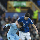 Everton's Gareth Barry, right, keeps hold of Manchester City's Samir Nasri during the English Premier League soccer match between Everton and Manchester City at Goodison Park Stadium, Liverpool, England, Saturday Jan. 10, 2015