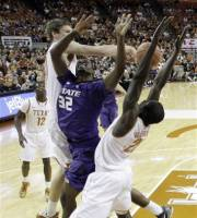 Kansas State Jamar Samuels (32) is blocked by Texas' Clint Chapman, left, as Alexis Wangmene, right, helps defend during the first half of an NCAA college basketball game, Saturday, Feb. 11, 2012, in Austin, Texas. (AP Photo/Eric Gay)