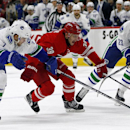 Carolina Hurricanes' Patrick Dwyer (39) drives between Vancouver Canucks' Linden Vey (7) and Alexander Edler (23), of Sweden, during the second period of an NHL hockey game in Raleigh, N.C., Friday, Jan. 16, 2015 The Associated Press