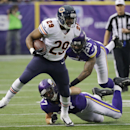 Chicago Bears running back Michael Bush (29) runs from Minnesota Vikings defenders Audie Cole and Marvin Mitchell (55) during the first half of an NFL football game Sunday, Dec. 1, 2013, in Minneapolis The Associated Press