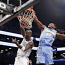 Brooklyn Nets forward Kevin Garnett, left, dunks in front of Denver Nuggets forward Kenneth Faried (35) in the first half of an NBA basketball game Tuesday, Dec. 3, 2013, in New York The Associated Press