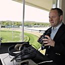 New track announcer Larry Collmus checks out his booth high atop the grandstand at Churchill Downs in Louisville, Ky., Wednesday, April 23, 2014. Collmus replaces British announcer Mark Johnson, who had called Churchill races since 2009. (AP Photo/Garry Jones)
