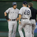 New York Yankees center fielder Jacoby Ellsbury (22) stands on second as New York Yankees manager Joe Girardi (28) comes out to talk during an interleague baseball game against the Washington Nationals at Nationals Park, Tuesday, May 19, 2015, in Washington. (AP Photo/Alex Brandon)