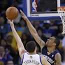 Memphis Grizzlies guard Courtney Lee, right, blocks a shot by Golden State Warriors guard Klay Thompson (11) during the first half of an NBA basketball game Friday, March 28, 2014, in Oakland, Calif The Associated Press
