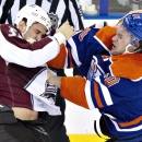 Colorado Avalanche Patrick Bordeleau (58) and Edmonton Oilers Luke Gazdic (20) fight during third period NHL hockey action in Edmonton, Alberta, Thursday, Dec. 5, 2013 The Associated Press