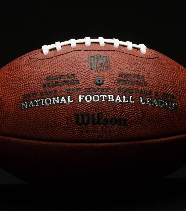 Official game balls for the NFL football Super Bowl XLVIII made at the Wilson Sporting Goods Co. in Ada, Ohio, Monday, Jan. 20, 2014. The Seattle Seahawks will play the Denver Broncos in the Super Bowl on Feb. 2 in New Jersey