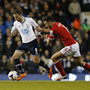 Tottenham Hotspur's Roberto Soldado, left, competes with Cardiff City's Steven Caulker during their English Premier League soccer match at White Hart Lane, London, Sunday, March 2, 2014