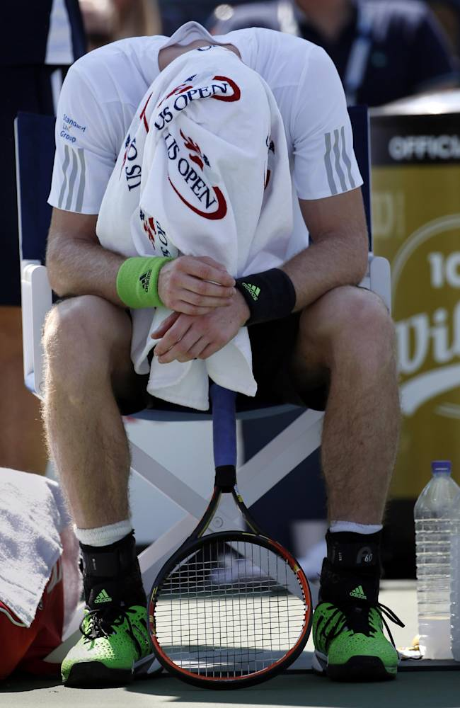 Andy Murray, of the United Kingdom, takes a break between games against Robin Haase, of the Netherlands, during the opening round of the 2014 U.S. Open tennis tournament, Monday, Aug. 25, 2014, in New York