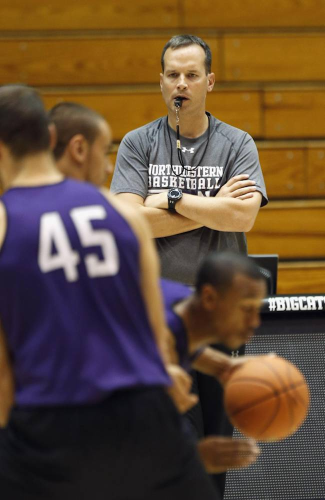 In this Monday, Oct. 28, 2013, photo, Northwestern new head basketball coach Chris Collins watches over team practice in Evanston, Ill. Collins was hired in the offseason and they believe he is the man to establish the Wildcats as contenders in the Big Ten and shoo away that NCAA tournament albatross hovering above them. He is embracing the challenge