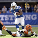 Indianapolis Colts running back Ahmad Bradshaw (44) runs out of the tackle of Cincinnati Bengals' Vontaze Burfict (55) during the first half of an NFL football game Sunday, Oct. 19, 2014, in Indianapolis The Associated Press