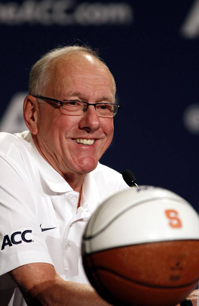 Syracuse coach Jim Boeheim smiles during a press conference at the Atlantic Coast Conference NCAA college basketball media day in Charlotte, N.C., Wednesday, Oct. 16, 2013