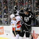 Calgary Flames center Mikael Backlund (11), of Sweden, and Los Angeles Kings center Anze Kopitar (11), of Slovenia, battle for the puck during the first period of an NHL hockey game Saturday, Nov. 30, 2013, in Los Angeles The Associated Press