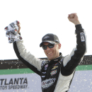 Driver Kevin Harvick celebrates after winning the NASCAR Xfinity series auto race at Atlanta Motor Speedway Saturday, Feb. 28, 2015, in Hampton, Ga. (AP Photo/John Amis)