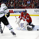 Dallas Stars left wing Antoine Roussel (21), from France, has his shot blocked by Washington Capitals goalie Jaroslav Halak (41), from the Czech Republic, in the second period of an NHL hockey game, Tuesday, April 1, 2014, in Washington The Associated Pre
