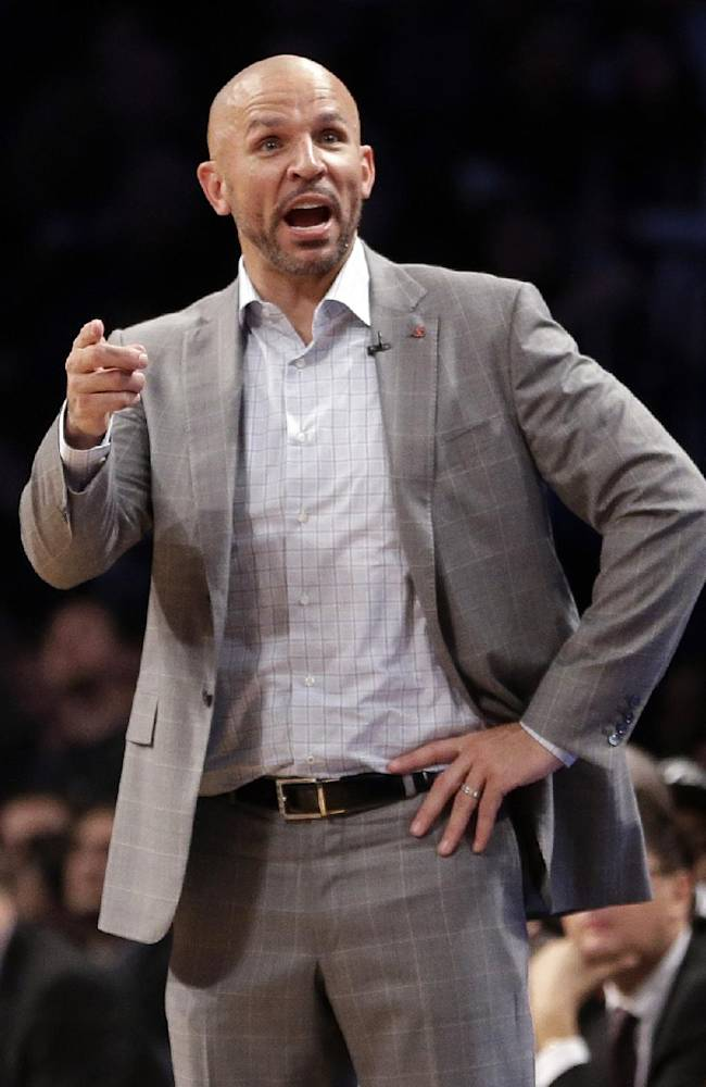 Brooklyn Nets coach Jason Kidd gestures to his team during the second half of Game 3 of an NBA basketball first-round playoff series against the Toronto Raptors on Friday, April 25, 2014, in New York. The Nets won 102-98