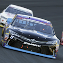Denny Hamlin (11) races out of Turn 4 during the NASCAR Sprint Cup series auto race at Charlotte Motor Speedway in Concord, N.C., Sunday, May 24, 2015. (AP Photo/Chuck Burton)
