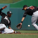 Nats clinch NL home-field edge, split with Marlins The Associated Press