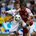 Vancouver Whitecaps' Brad Rusin, left, defends against Portland Timbers' Ryan Johnson, of Jamaica, during the first half of an MLS soccer game in Vancouver, British Columbia on Saturday, May 18, 2013
