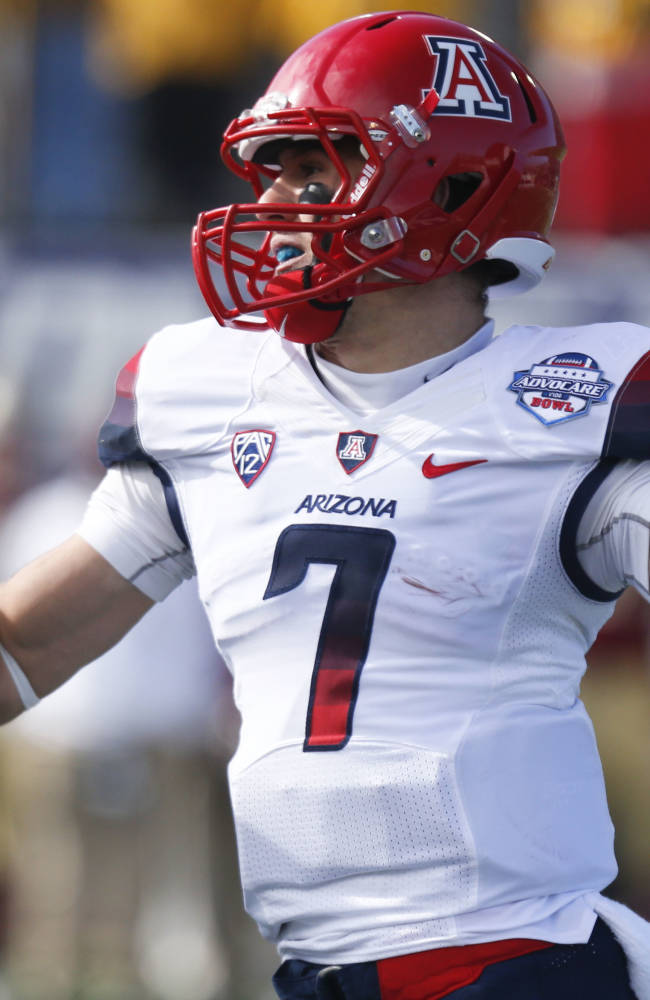 Arizona quarterback B.J. Denker (7) throws a pass against Boston College during the first half of the AdvoCare V100 Bowl NCAA college football game, Tuesday, Dec. 31, 2013, at Independence Stadium in Shreveport, La