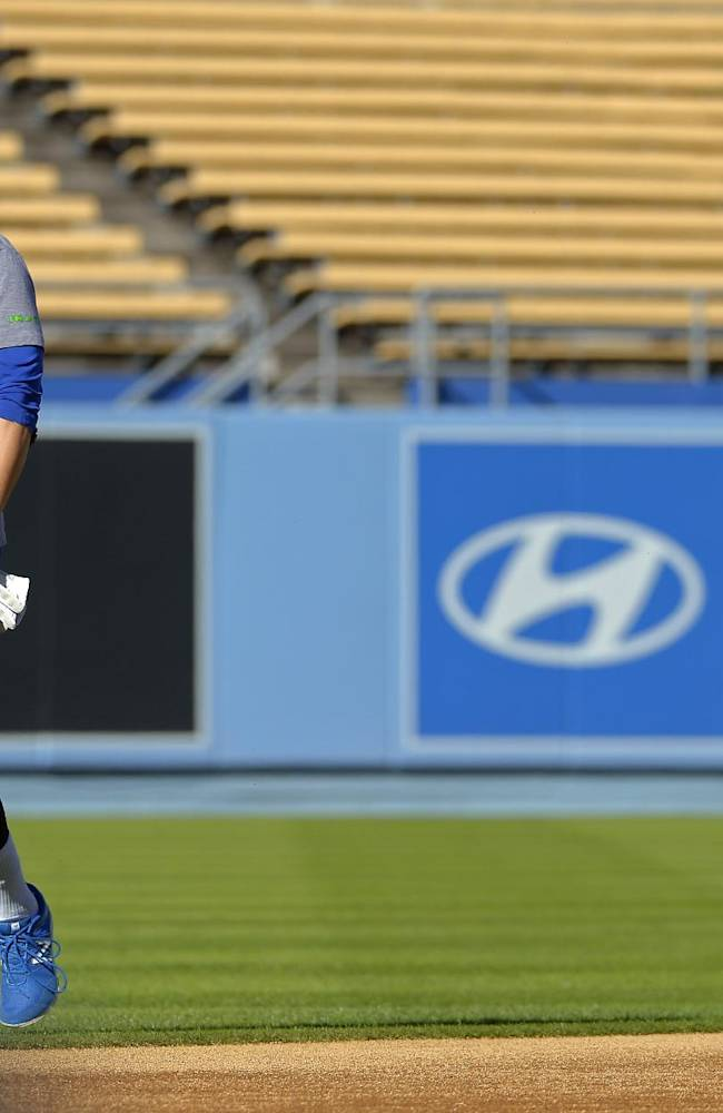 Los Angeles Dodgers' Andre Ethier walks of the field as his son Retton follows after practice in preparation for Game 3 of the National League baseball division series against the Atlanta Braves, Saturday, Oct. 5, 2013, in Los Angeles