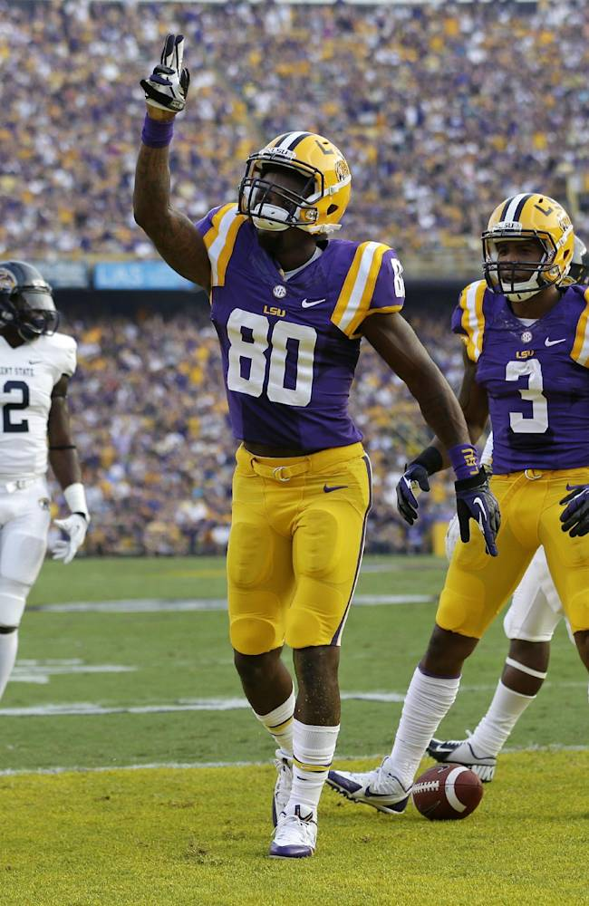 In this Sept. 14, 2013, file photo, LSU wide receiver Jarvis Landry (80) celebrates his touchdown reception with wide receiver Odell Beckham (3) in front of Kent State cornerback Malcom Pannell (2) during the first half of an NCAA college football game in Baton Rouge, La. Beckham and Landry combined for more than 2,300 yards and 18 touchdowns receiving for LSU last season. Now the best of friends are about to join the NFL, where they'll likely have to find their way without each other