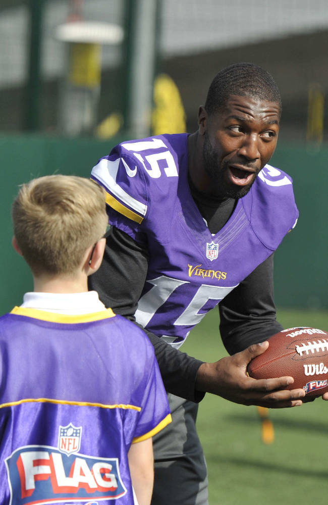 Greg Jennings of the Vikings takes part in a coaching clinic for London children near Wembley Stadium, London, Tuesday Sept. 24, 2013. The Pittsburgh Steelers are to play the Minnesota Vikings in the NFL International Series at Wembley Stadium in London on Sunday, Sept 29