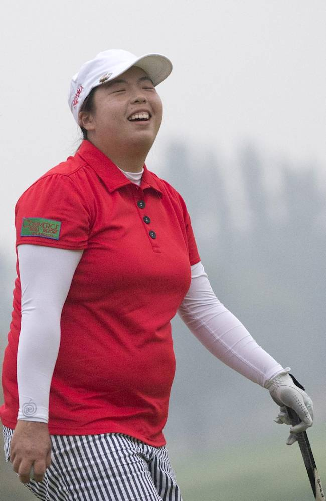China's Feng Shanshan smiles after her eagle shot on the 18th green to win the Reignwood LPGA Classic golf tournament at Pine Valley Golf Club on the outskirts of Beijing, China, Sunday, Oct. 6, 2013