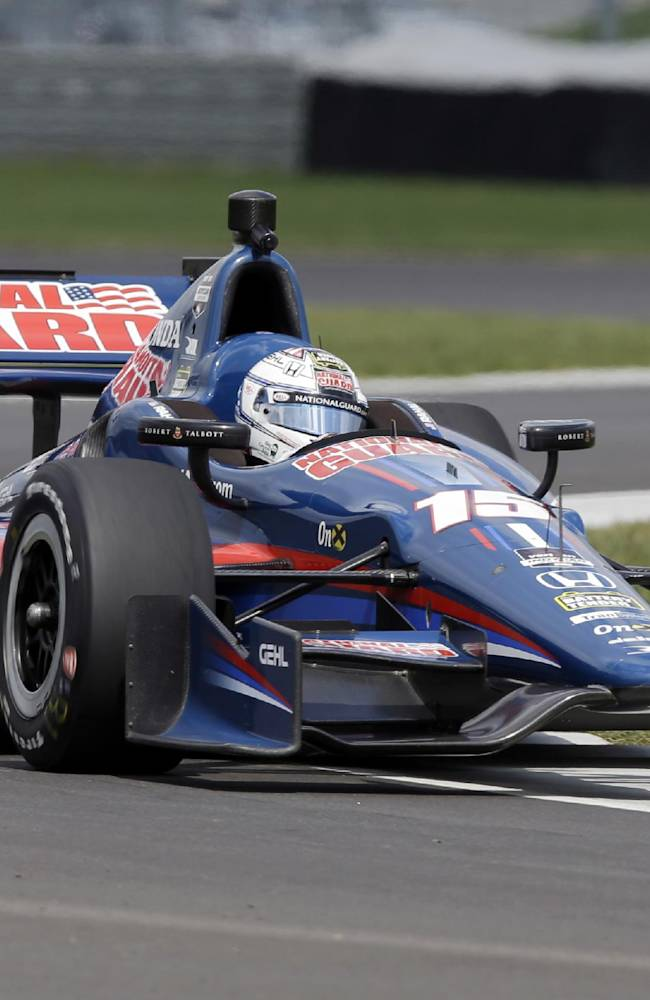 Graham  Rahal takes a turn during testing for the inaugural Grand Prix of Indianapolis auto race on the new road course at Indianapolis Motor Speedway in Indianapolis, Wednesday, April 30, 2014