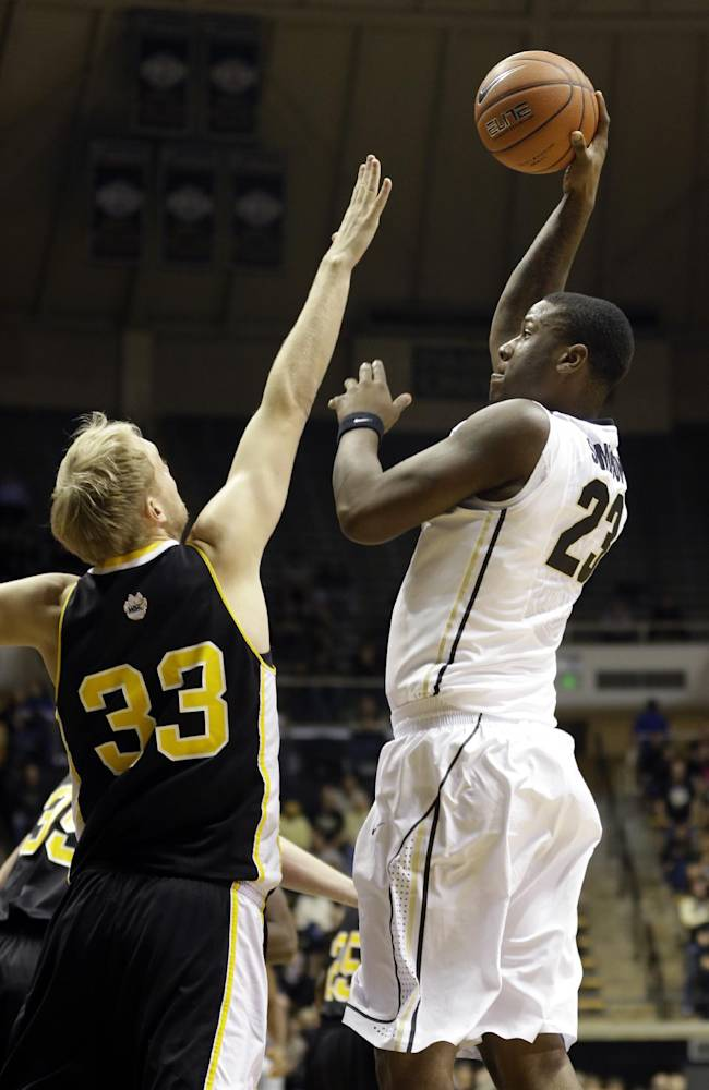 Purdue forward Jay Simpson, right, shoots over Wayne State College's Jared Bartling in the second half of an NCAA college exhibition basketball game in West Lafayette, Ind., Monday, Nov. 4, 2013. Purdue defeated Wayne State College 91-58