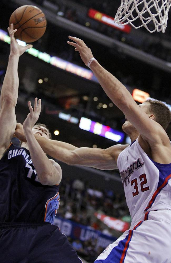 Charlotte Bobcats center Cody Zeller, left, shoots and is fouled by Los Angeles Clippers forward Blake Griffin (32) during the second half of an NBA basketball game Wednesday, Jan. 1, 2014, in Los Angeles. The Clippers won 112-85
