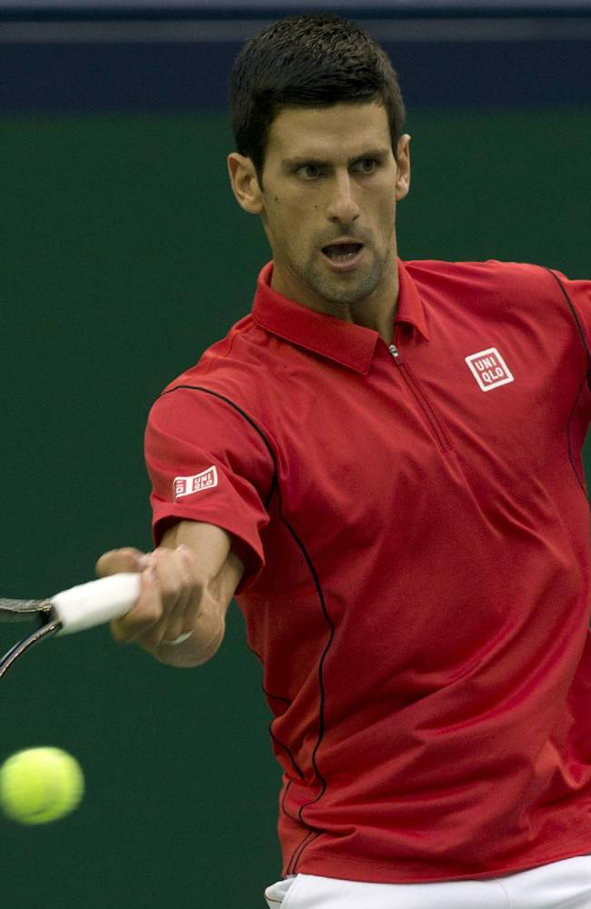 Serbia's Novak Djokovic returns the ball during a match against Spain's Marcel Granollers for the Shanghai Masters tennis tournament at the Qizhong Forest Sports City Tennis Center in Shanghai, China, Wednesday, Oct. 9, 2013. Djokovic won 6-2, 6-0